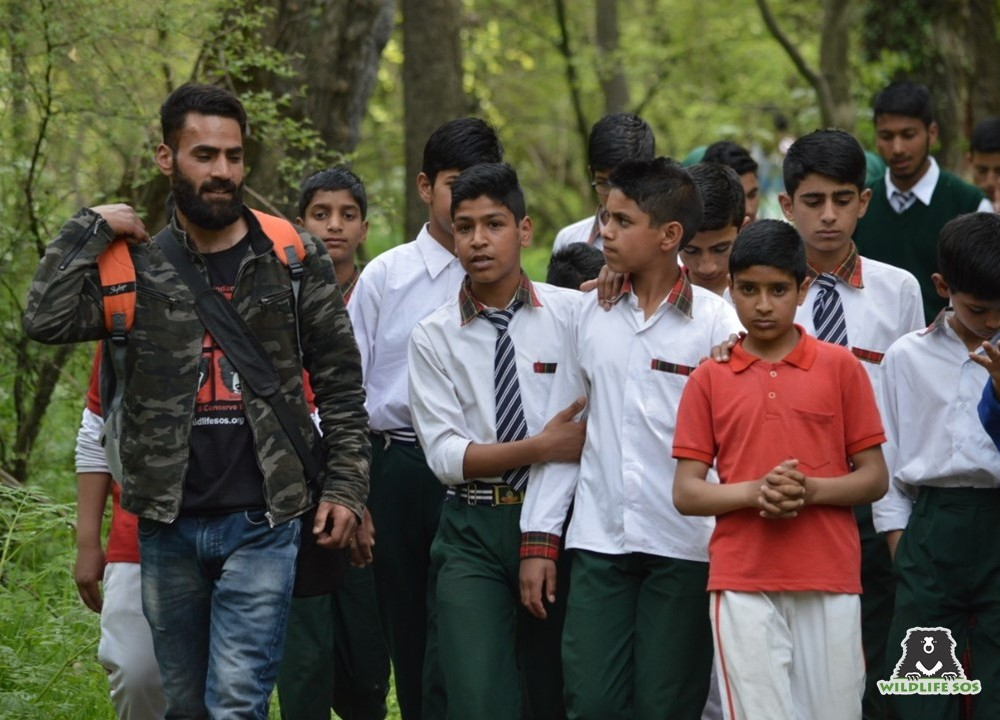 Shabir with a group of school children, last year, on one of their visits to the Dachigam Bear Rescue Centre!
