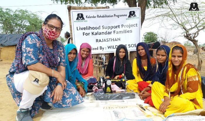 Ms. Rakhee Sharma with the women of the Kalandar community.