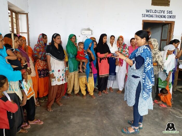 Rakhee Sharma leading a briefing with the women of the Kalandar community.